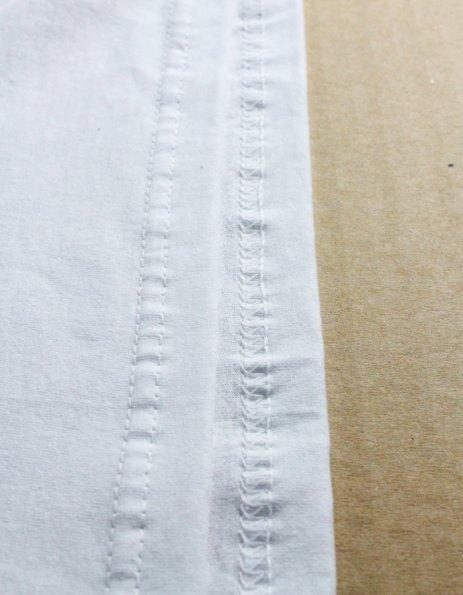 Cucitura inferiore maglietta